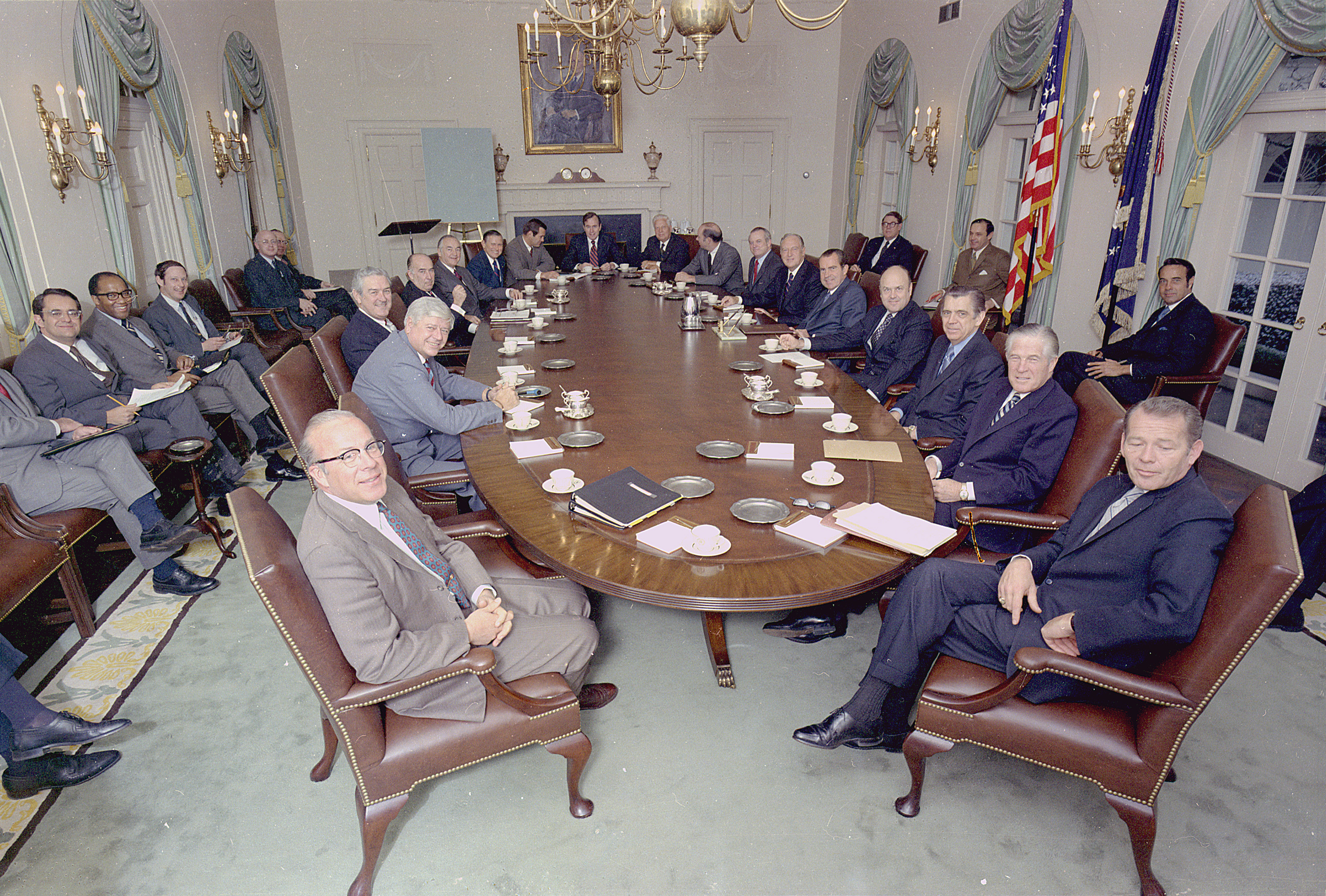 Richard M. Nixon posing with his cabinet in the cabinet room in the White House.