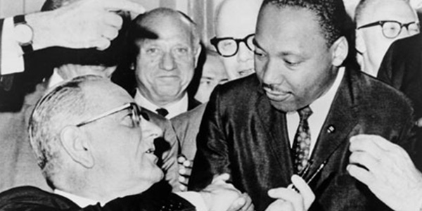 President Lyndon Baines Johnson Giving Dr. Martin Luther King a Pen as He Signs the Voting Rights Act