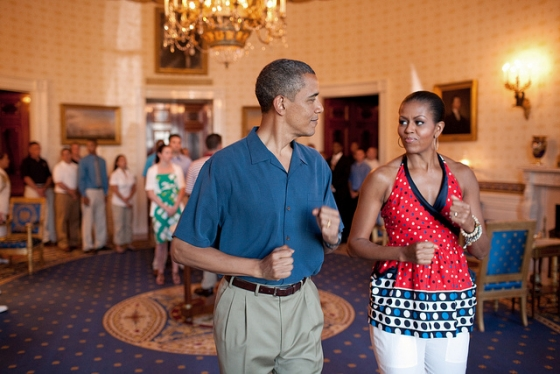 President Barack Obama and First Lady Michelle Obama pretend to march to music in the Blue Room