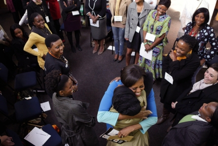 First Lady Michelle Obama receives a hug while meeting with Young African Women Leaders Forum