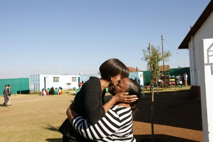 First Lady Michelle Obama is greeted in Soweto
