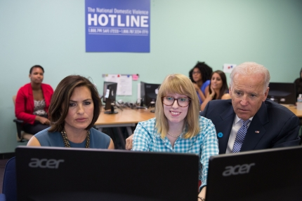 Vice President Joe Biden and Mariska Hargitay watch as an advocate demonstrates the new web chat feature, at the National Domestic Violence Hotline