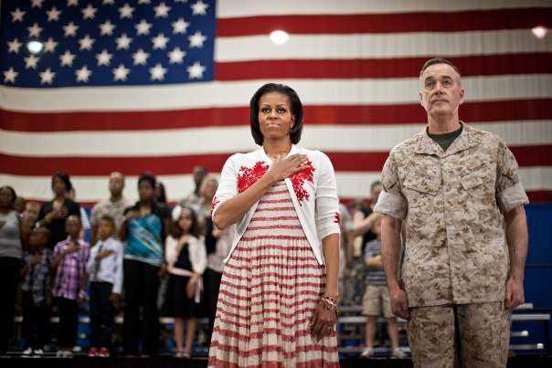 First Lady Michelle Obama stands for the Pledge at a Joining Forces event