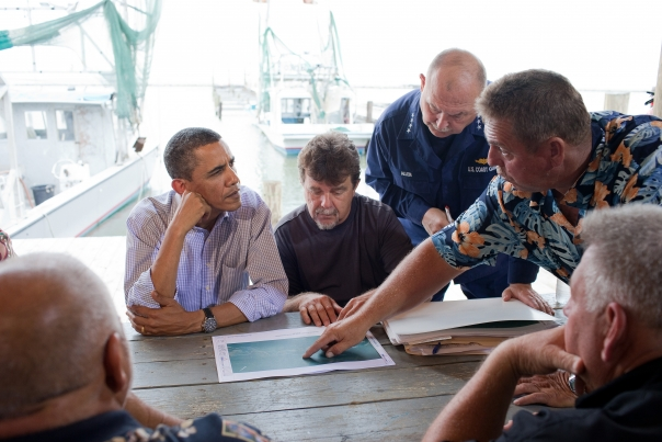 President Barack Obama looks at maps of local estuaries with Mayor David Camardelle