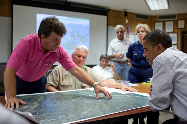 Grand Isle (Louisiana) Mayor David Camardelle points out areas on a map