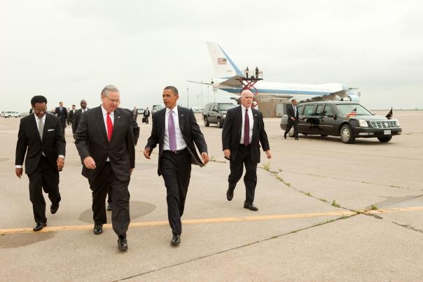 President Barack Obama walks with Missouri Gov. Jay Nixon