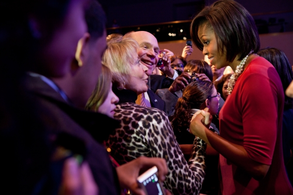First Lady Michelle Obama greets guests at the National League of Cities
