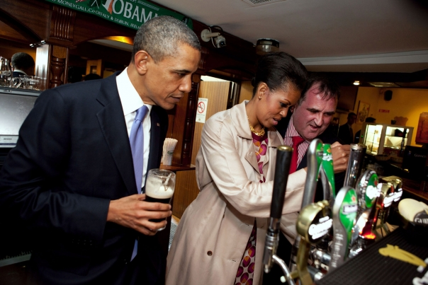 First Lady Michelle Obama Draws a Pint at Ollie Hayes' Pub