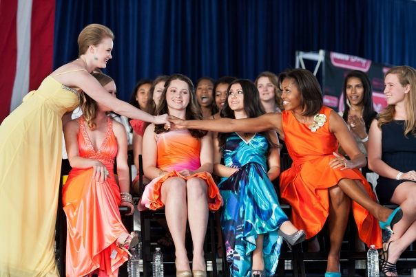 First Lady Michelle Obama Participates In A Prom Fashion Show