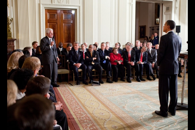 President Barack Obama listens as Sen. Ted Kennedy addresses a Health Care Summit second session with members of Congress in the East Room of the White House March 5, 2009.