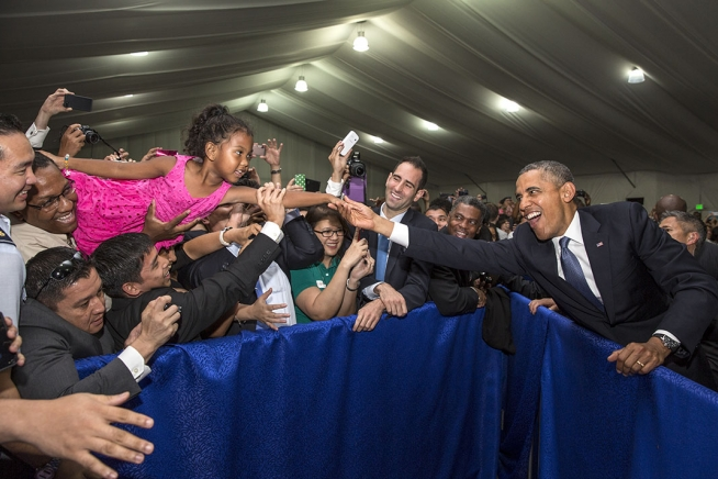 April 2014 photo of the day the white house president barack obama stretches to shake the hand of a young girl held aloft during a us embassy meet and greet at the sofitel hotel in manila m4hsunfo