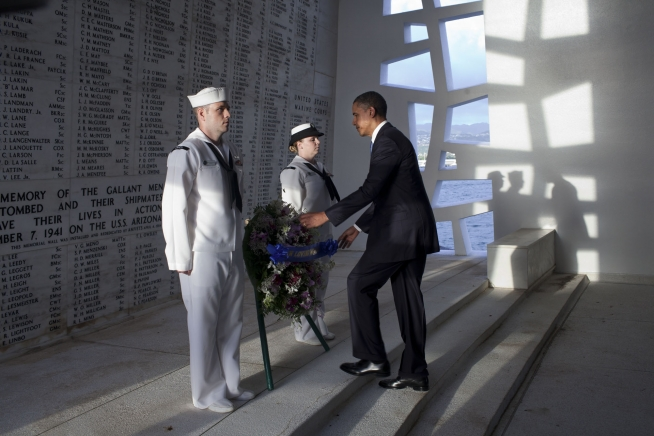 President Obama paid respects to those who died at Pearl Harbor on a visit in 2011; White House caption: President Barack Obama places a wreath at the USS Arizona Memorial, part of the World War II Valor in the Pacific National Monument, in Pearl Harbor, Hawaii, Dec. 29, 2011. (Official White House Photo by Pete Souza)