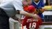 George W. Bush presents Angel Tavarez with a baseball