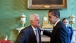 President Barack Obama talks alone with Sen. Edward Kennedy