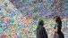 First Lady Michelle Obama Views Graffiti Artist's Murals