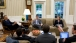 President Obama Meets with Staff in the Oval Office