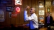 President Barack Obama throws darts at Manuel's Tavern