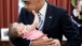 President Barack Obama holds six-month-old Talia Neufeld