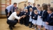 President Barack Obama and British Prime Minister David Cameron visit with students while touring Enniskillen Primary School