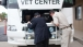 Secretary Shinseki Checks Under the Hood of a Mobile Vet Center