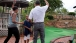 President Barack Obama and First Lady Michelle Obama play mini golf with daughter Sasha in Panama City Beach, Fla