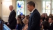 President Obama and Vice President Biden Stand in Church