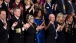 First Lady Michelle Obama And Guests Applaud
