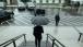 President Obama departs the EEOB under an umbrella