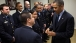 President Obama Is Presented A Challenge Coin By An Emergency Responder