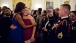 First Lady Michelle Obama Poses With a Guest at the Department of Defense Dinner