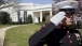 A Marine Salutes as President Obama Returns to the Oval Office