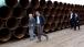 President Obama Walks At TransCanada Stillwater Pipe Yard