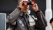 President Barack Obama Uses Binoculars To View The DMZ