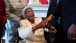 President Barack Obama greets 109-year-old Emma Primas