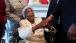 President Barack Obama greets 109-year-old Emma Primas
