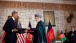 President Barack Obama And Afghan President Hamid Karzai Exchange Documents