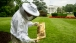 Beekeeper Charlie Brandts works with the beehive on the South Grounds
