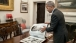 President Obama looks at photos of Muhammad Ali