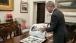 President Obama looks at photos of Muhammad Ali