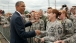 President Barack Obama Jokes With Military Personnel