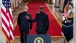 President Barack Obama walks down the Cross Hall with Vice President Joe Biden
