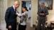 National Security Advisor Rice Helps Vice President Biden