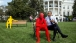 President Barack Obama sits with a Lego statue