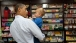 President Obama Holds a Child in Mast General Store
