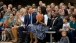 Prince Harry of Wales Hands First Lady Michelle Obama a Basketball