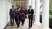 President Obama Walks with Senior Advisors on the Colonnade of the White House