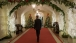 President Obama Walks Through The Ground Floor Corridor