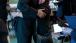 Roxana Giron hugs President Barack Obama