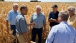 President Barack Obama talks with farmers during a tour of the McIntosh family farm