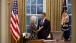 President Obama talks with Secretary Sebelius